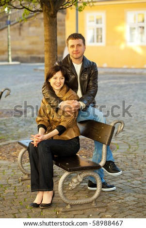 love couple sitting on a bench - stock photo