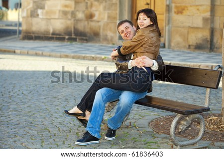 love couple sitting on the bench - stock photo