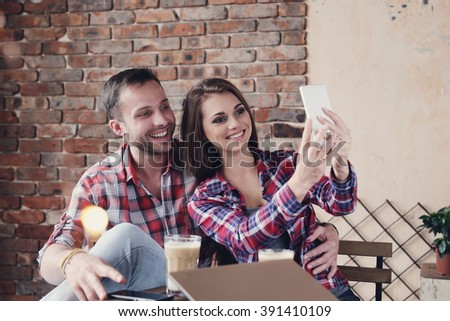 Love. Cute couple in the cafe - stock photo