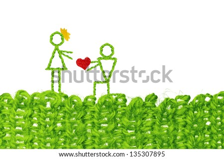 Love expression concept, knelt male giving heart to female. Infant simplicity design from woolen knit with text space - stock photo
