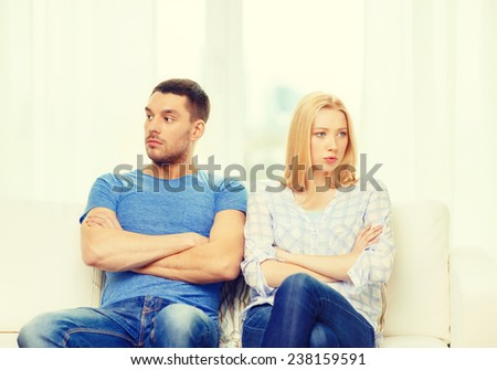 love, family and happiness concept - unhappy couple not speaking after having argument at home - stock photo
