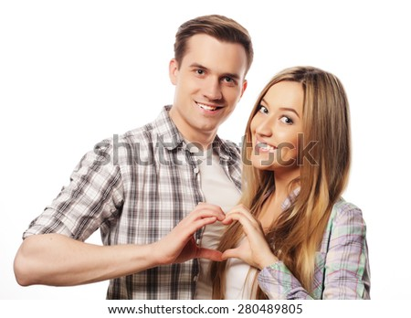 Love, family and people concept: Happy couple in love showing heart with their fingers - stock photo