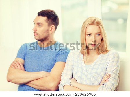 love, family and relationship problems concept - unhappy couple not speaking after having argument at home - stock photo