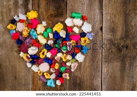 Love flower heart on wooden dark background - stock photo