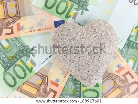 Love for money concept. Heart on European currency - stock photo
