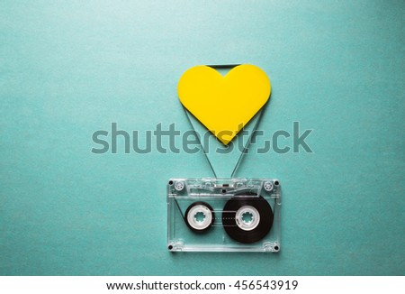 love for music, audio cassette with yellow heart on a green background