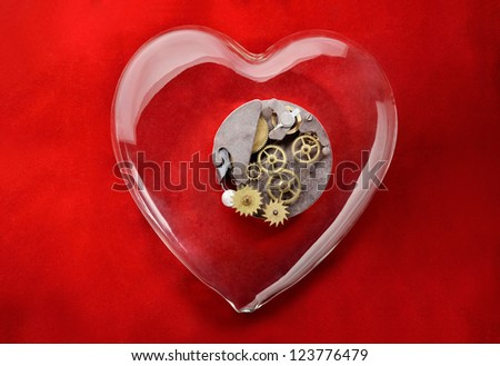 Love gear. Gear wheels inside glass heart with red background - stock photo
