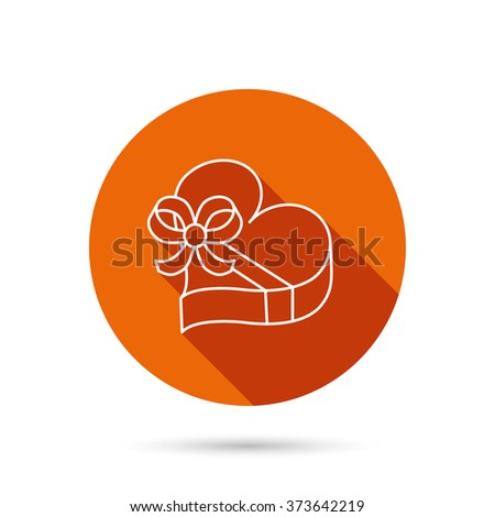 Love gift box icon. Heart with bow sign. Round orange web button with shadow. - stock photo