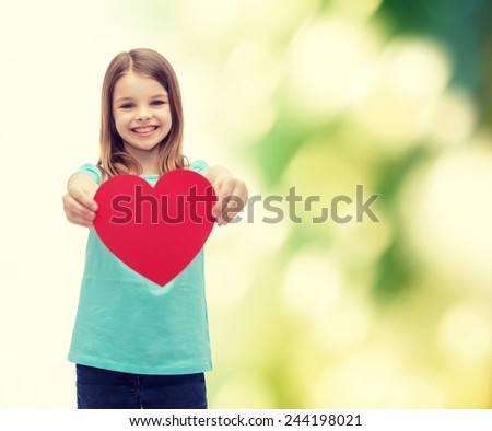 love, happiness and people concept - smiling little girl giving red heart - stock photo