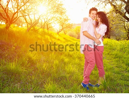 Love. Happy couple. Love story. Man and woman couple. Sunset, city park, outdoor, spring, summer - love concept. - stock photo