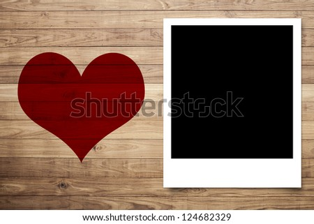 Love heart and Photo frame on Brown wood plank wall texture background - stock photo