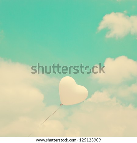 Love Heart Balloon in Vintage Blue Sky - stock photo
