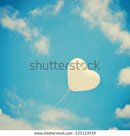 Love Heart Balloon in Vintage Blue Sky - stock photo