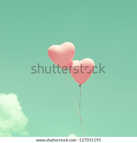 Love heart balloons on vintage sky - stock photo