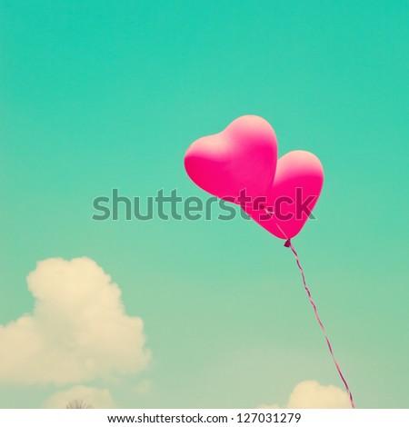 Love heart balloons on vintage sky - stock photo