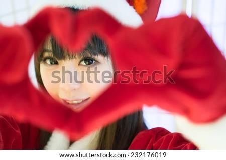 love heart hand Christmas sexy girl  mrs. Santa  moe  - stock photo