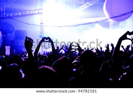 Love Heart Hands In Air At Festival - Crowd - stock photo