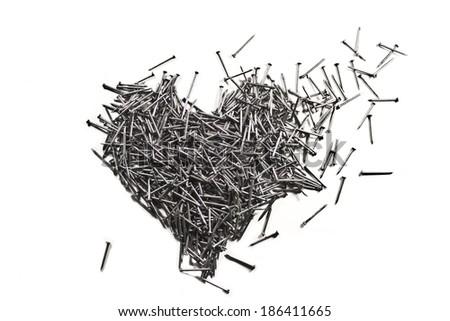 Love heart made of shiny iron nails - stock photo
