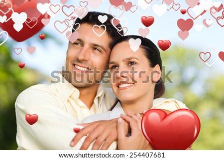 Love heart pattern against keyhole door in dark room - stock photo