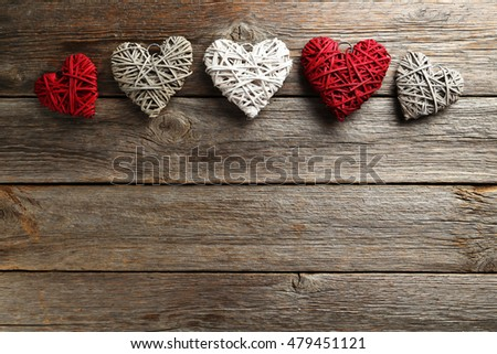 Love hearts on a grey wooden background