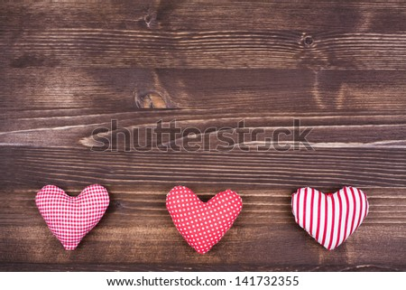 Love hearts on vintage wood for Valentine card - stock photo