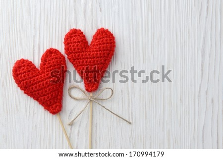 Love hearts on white wooden texture background, valentines day card concept - stock photo