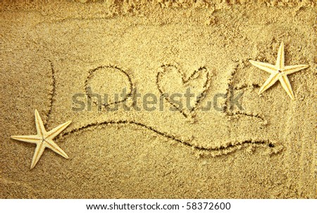 Love in the sand with starfish - stock photo