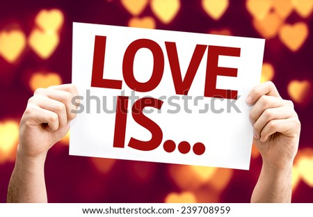 Love Is ... card with heart bokeh background - stock photo