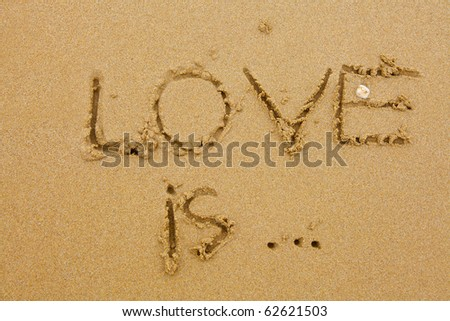 Love is inscription on the sand - stock photo