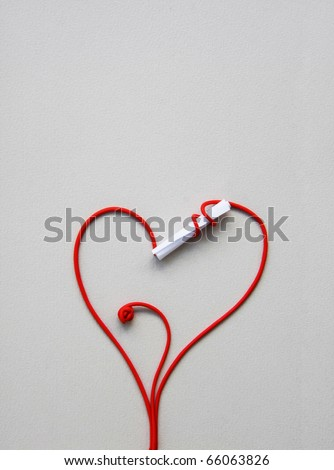 love letter: A stalk rolled up around a closed paper keeping its contents secret and drawing a red heart for valentine day - stock photo