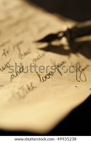 Love letter and antique quill on a black background - stock photo