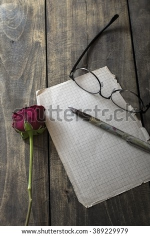 Love letter and rose on wooden background, from above - stock photo