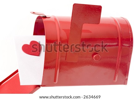 Love letter in a red mailbox isolated on white - stock photo