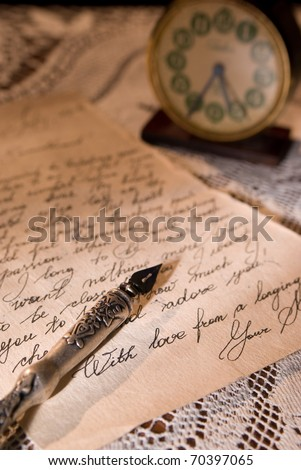 Love letter with antique quill on a tablecloth - stock photo
