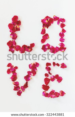 LOVE lettering made of rose petals - stock photo