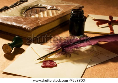 Love letters with a quill, an inkwell & a stamp on a rustic paper.  Valentine Card. - stock photo