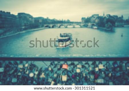 Love locks bridge in Paris. Blurred toned photo.  - stock photo