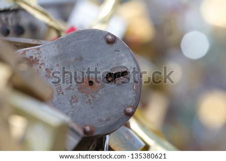 Love locks in Paris bridge symbol of  friendship and romance - stock photo