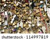 Love locks in Paris representing secure friendship and romance - stock photo