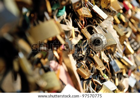 Love locks in Paris  representing secure friendship and romance - stock photo