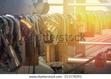 Love locks on a bridge close up shoot - stock photo