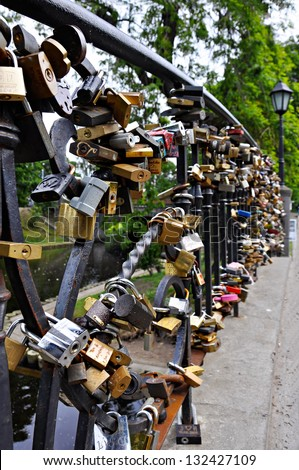 Love locks on bridge in Riga in the Bastion Hill park - stock photo