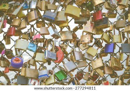 Love Locks On Pont des Arts Bridge Over The Seine In Paris, France - stock photo