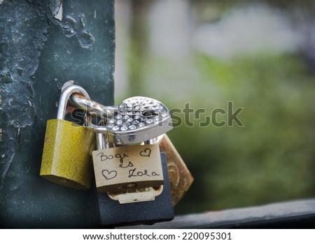 Love locks on the bridge - stock photo