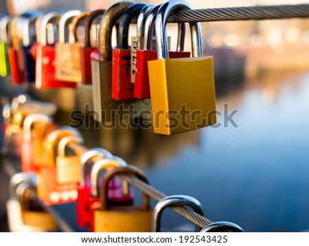 Love Locks on the bridge railing - stock photo