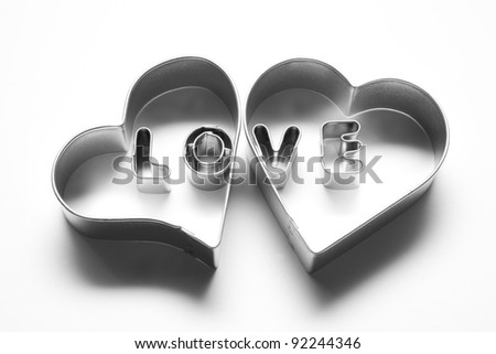 Love message in two hearts. Made of chrome metallic letters on white background