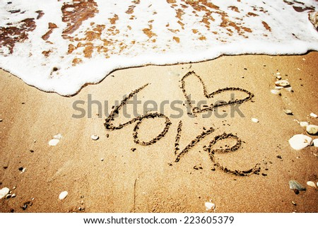 love message written in sand - stock photo