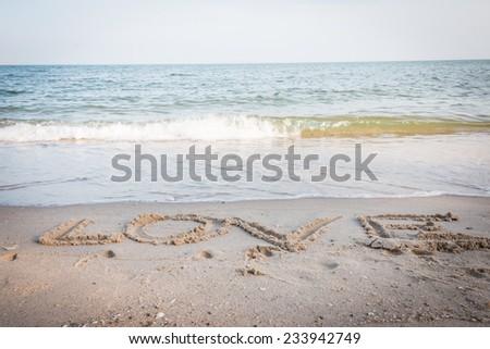 love message written in sand background - stock photo