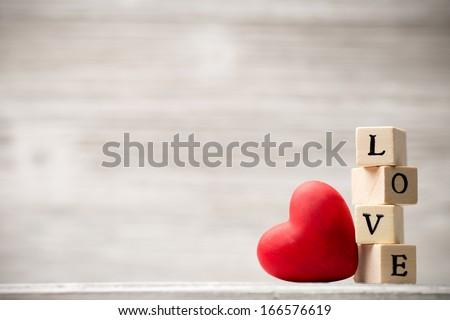 Love message written in wooden blocks. - stock photo