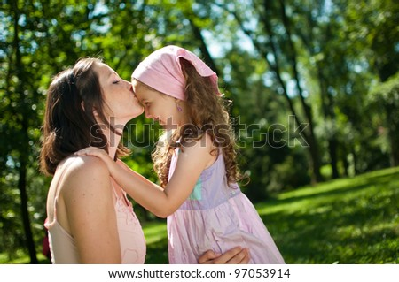 Love - mother kissing her child - stock photo